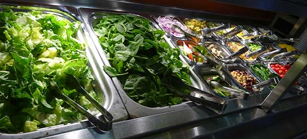 Photo of corporate food service salad bar.