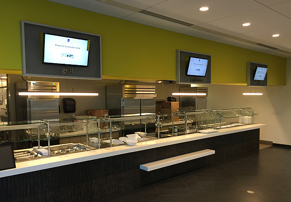 Photo of food stations at newly remodeled corporate cafeteria