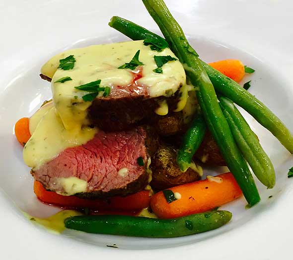 Photo of plated roast beef and green beans