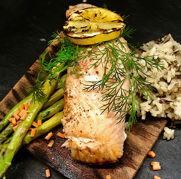 Photo of a salmon dish made at our corporate dining presentation cooking station.